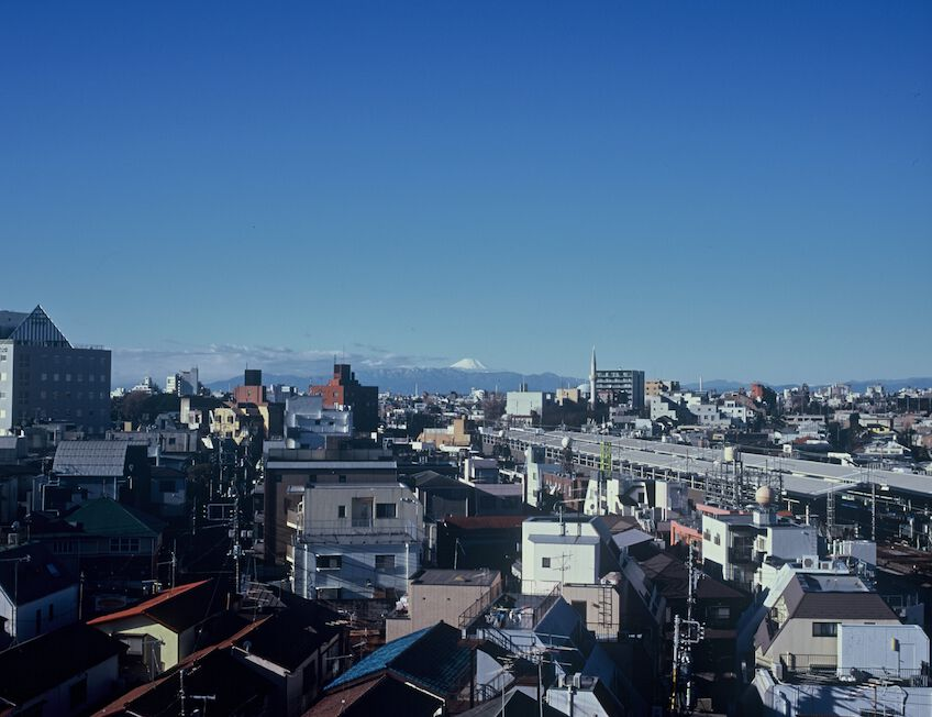 The skyline of Yoyogi Uehara from above with Mount Fuji visible in the distance