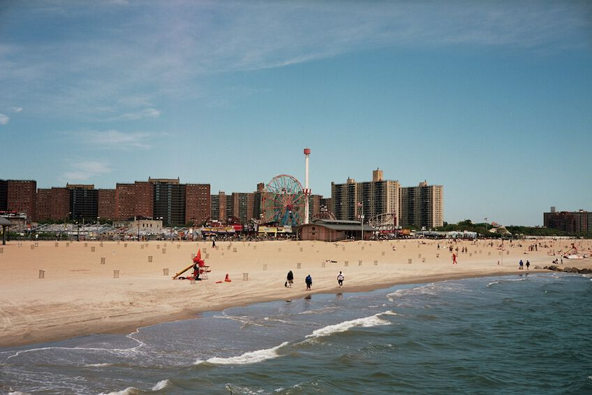 Coney Island beach with the ferris wheel in the background