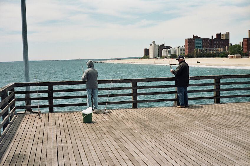 Two fishers at the pier
