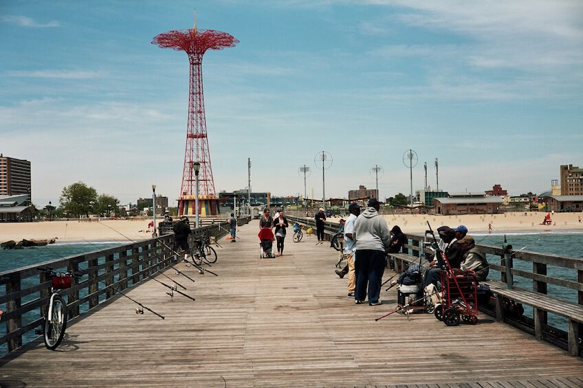 Pier with people sitting or walking around