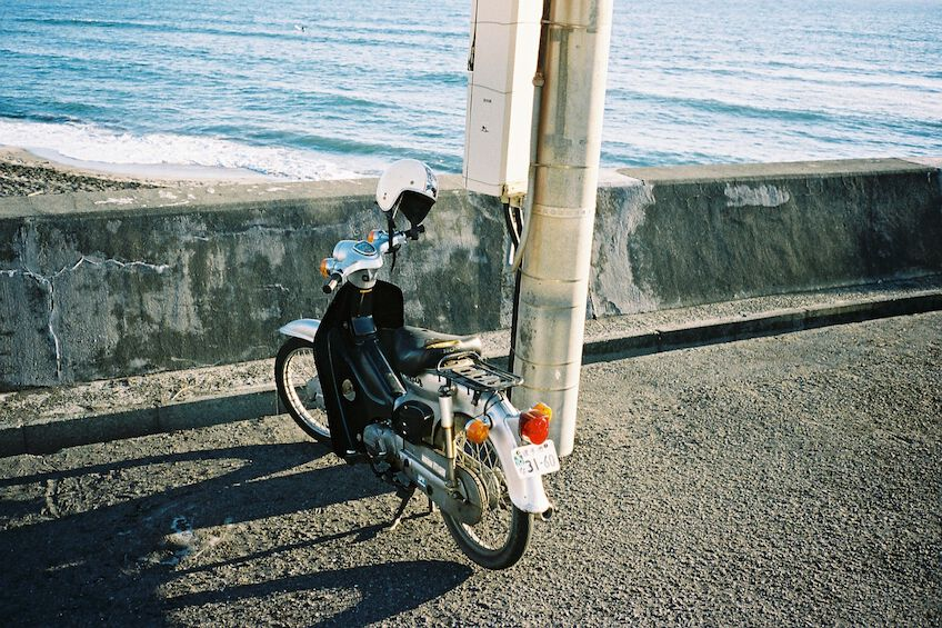 Parking motorbike next to the beach in Kamakura