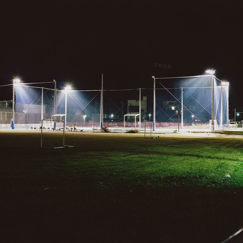 Sccer field lit by floodlight at night