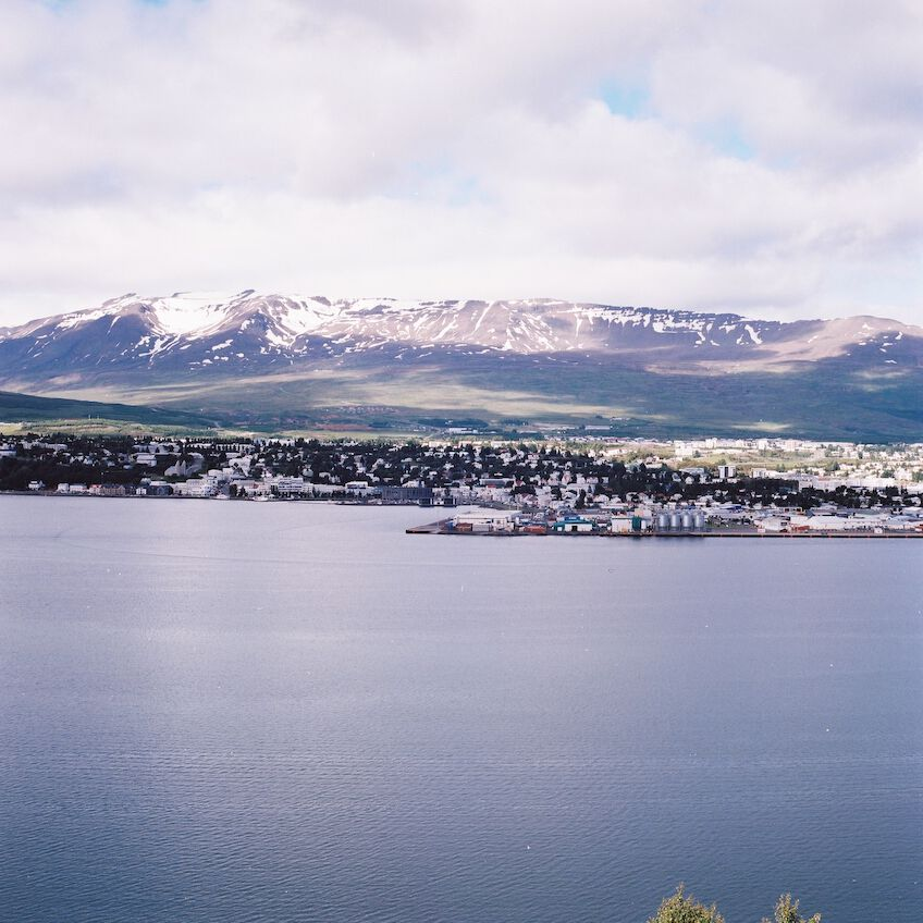 Akureyri from the other side of the bay with mountains in the background