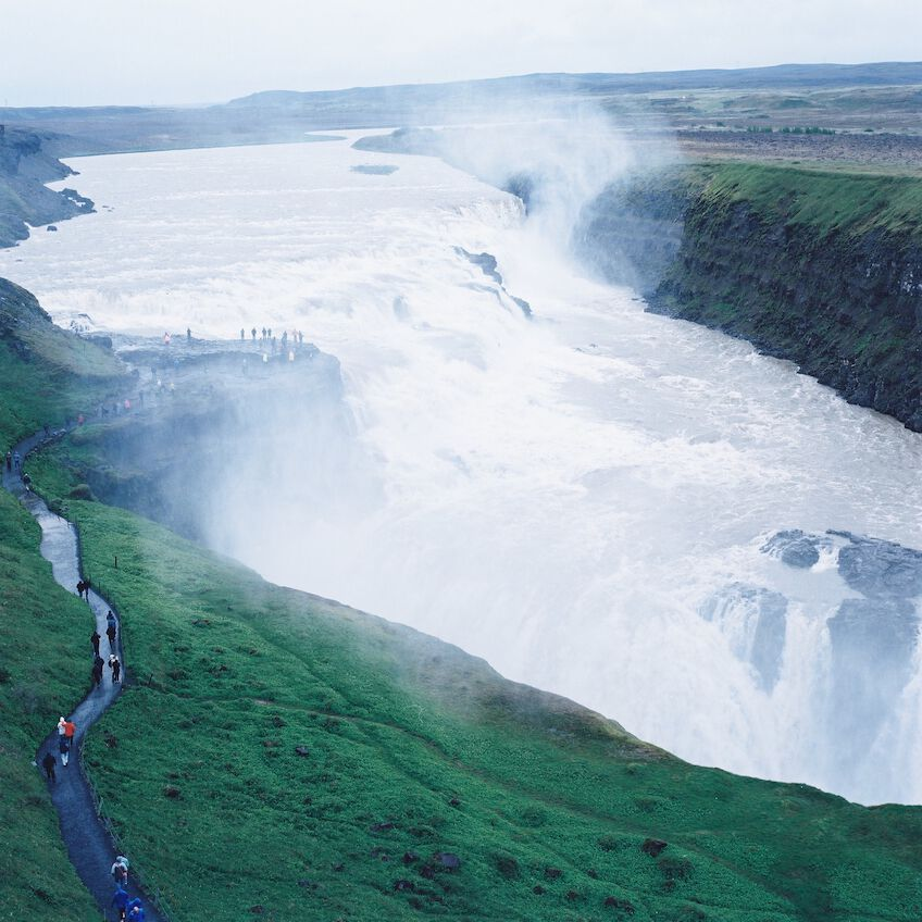 Walkway with people leading to Gullfoss waterfall