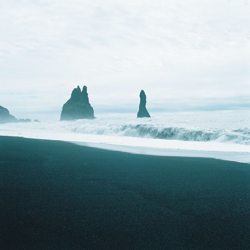 Waves crashing to the black sand shores of Reynisdrangar