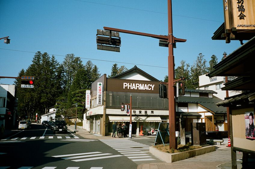 Crossing with a traffic light and a pharmacy on one corner