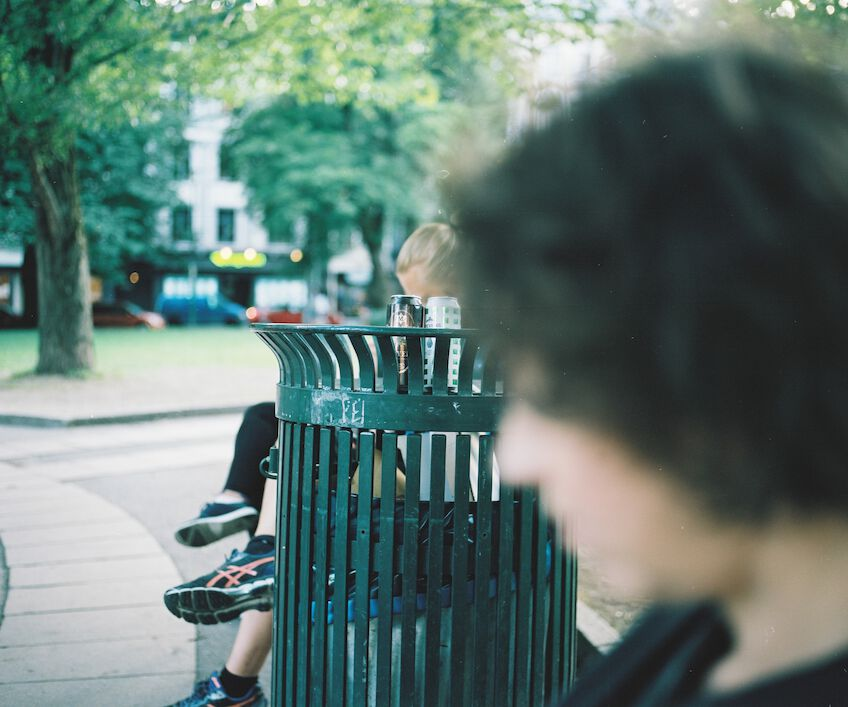 Out of focus woman on a park bench