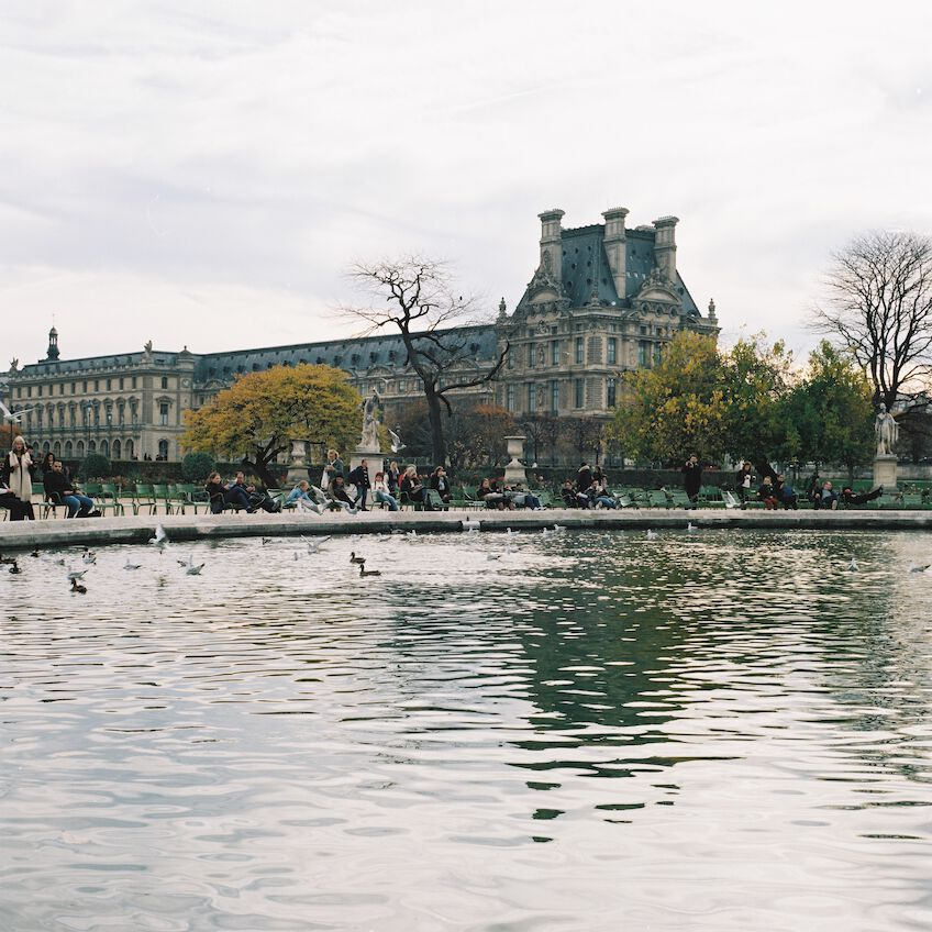 People sitting around Grand Bassin Rond in Paris