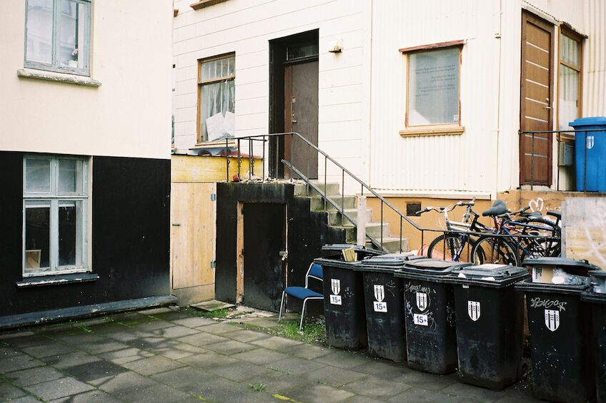 Garbage cans in front of a building