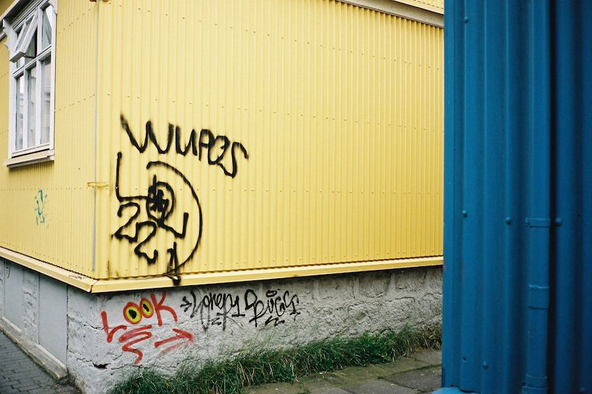 Graffiti on a yellow wall