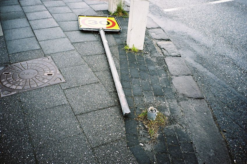 Fallen over road sign