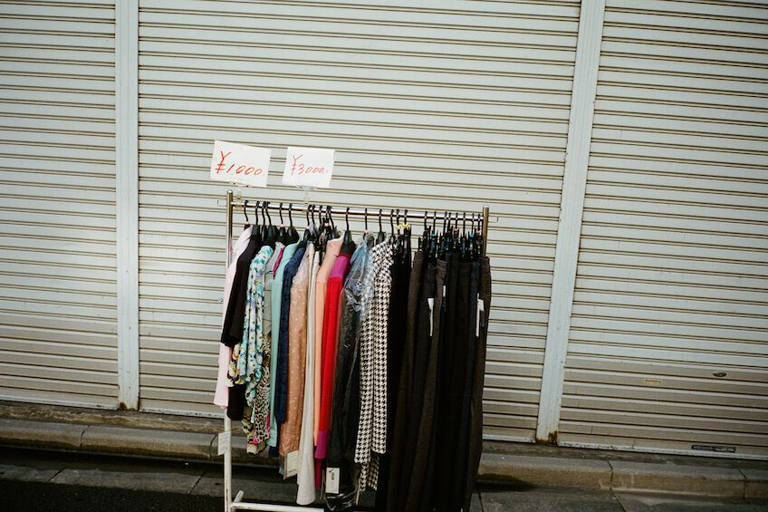 Clothes rack in front of a shop